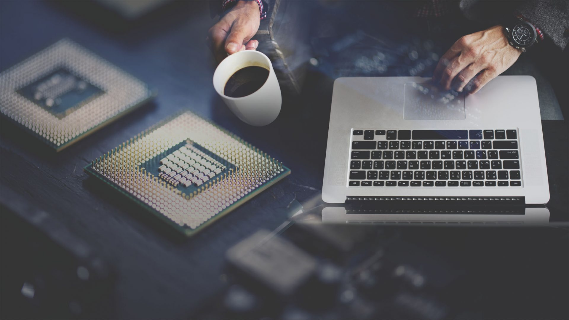 Computer programmer using a laptop